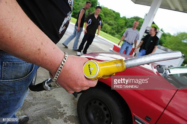 A fisherman fills the tank of a car full of diesel oilfor free on May 22 2008 at a mawl petrol station to protest against fuel costs and cuts in cod...