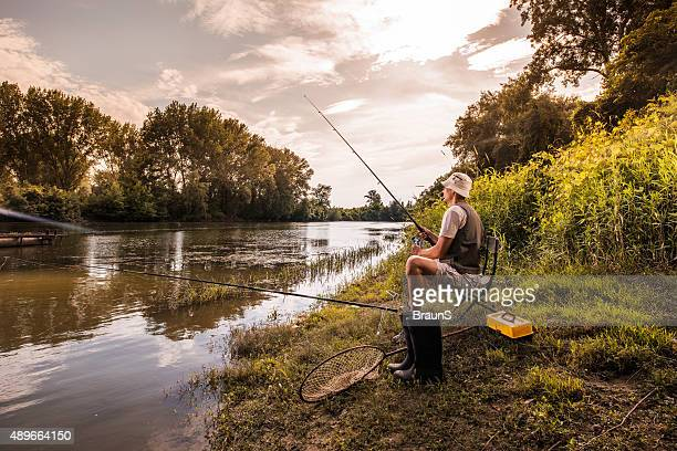 Fisherman fishing on the river and enjoying in a weekend.