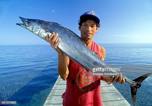 Fisherman Holding a Wahoo