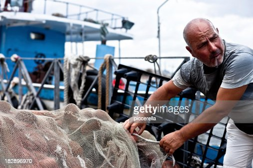 Fisherman Holding Fishing Net