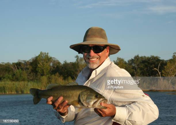 Fisherman Holding Large Mouth Bass
