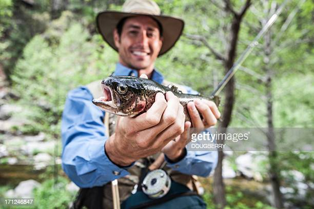 Fisherman holding Trout
