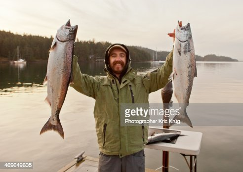Fisherman Holding Up King Salmon Chinook Fish