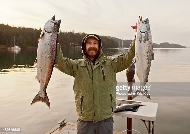 Fisherman Holding Up King Salmon Chinook Fish