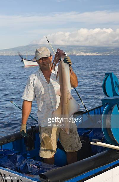 Fisherman hunting Veined Squids Loligo forbesi Azores Atlantic Ocean Portugal