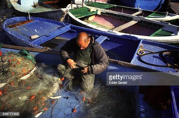 A fisherman in old Jaffa port Israel