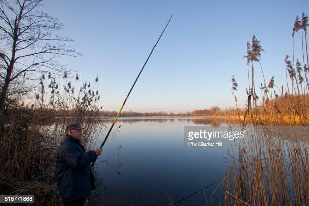 A fisherman in Uckermarkische Seen Natural park part of the The Feldberg Lake District Nature Park containing large lakes kettle bogs and an...