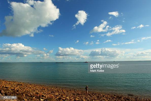 A fisherman is seen on the rocks on April 15 2012 in Darwin Australia Darwin is the most northerly capital city of Australia located on the Timor Sea...