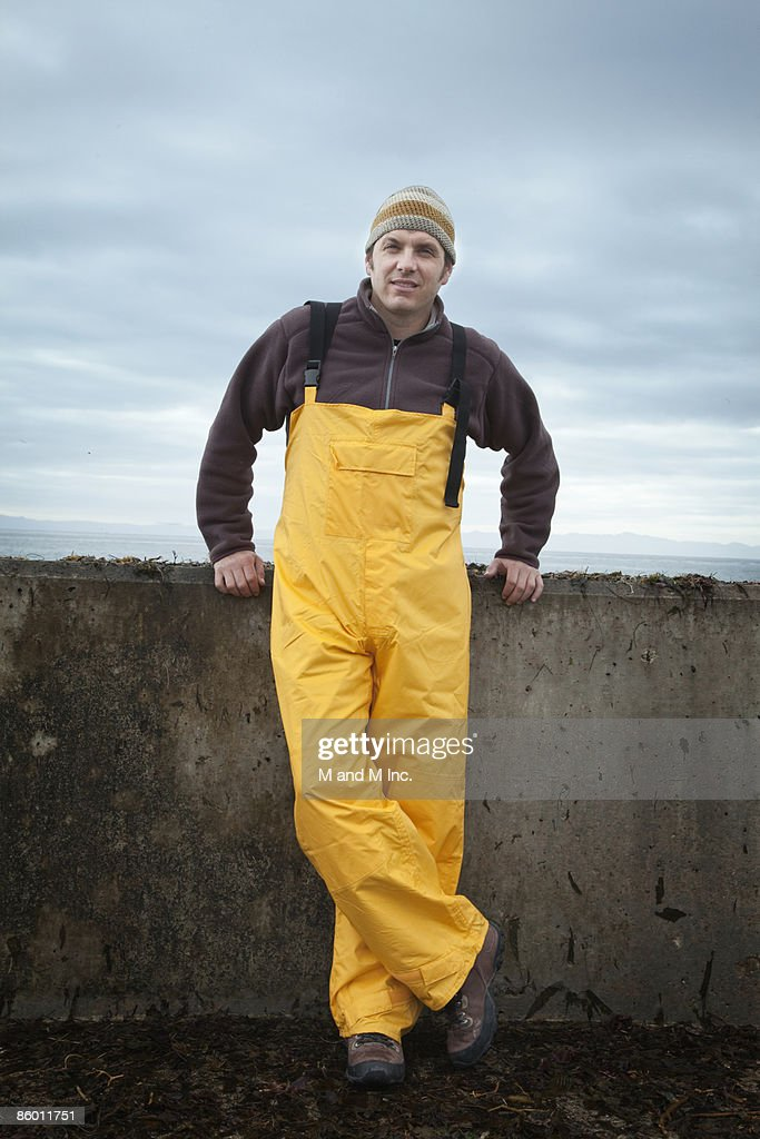 Fisherman Leaning Against Sea Wall : Stock Photo