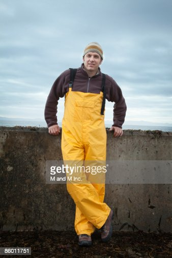 Fisherman Leaning Against Sea Wall