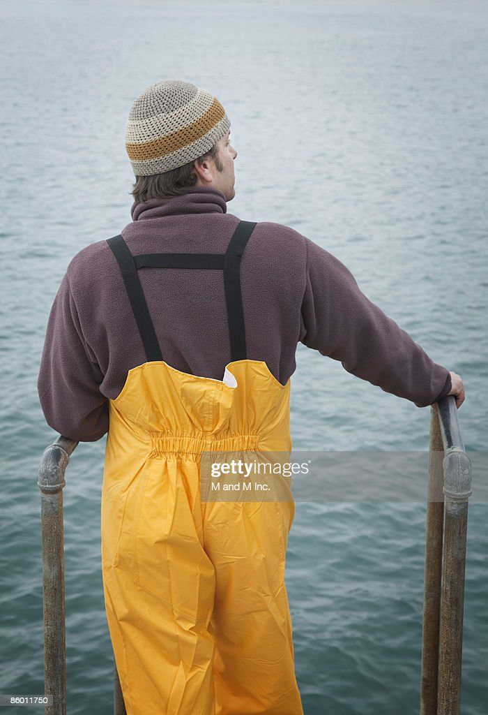 Fisherman Looking out to Sea : Stock Photo