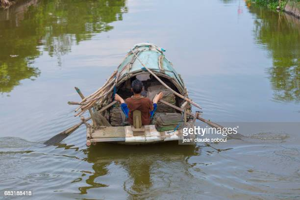 A fisherman, on a river, in ninh binh province (vietnam)