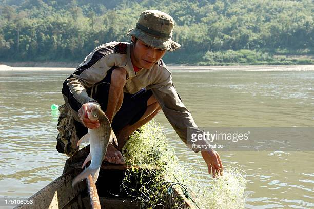 A fisherman on the Salween River a 2800 kilometres river which takes its source in western China and empties in the Andaman Sea in Burma On a 130...