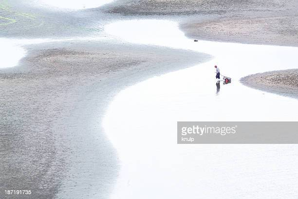 Fisherman on tidal flats
