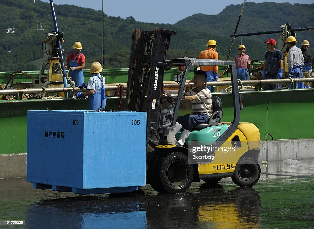 A fisherman operates a forklift truck as others work on a trawler at a port in Ofunato City, Iwate Prefecture, Japan, on Friday, Sept. 7, 2012. Japan's economy expanded in the second quarter at half the pace the government initially estimated, underscoring the risk of a contraction as Europe's debt crisis caps exports.Photographer: Akio Kon/Bloomberg via Getty Images