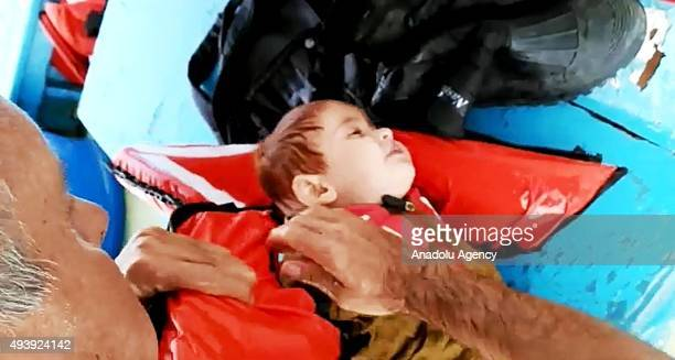 A fisherman performs first aid on Muhammad 15 years old Syrian refugee toddler as he found floating on the sea then rescued by Turkish fishermen...