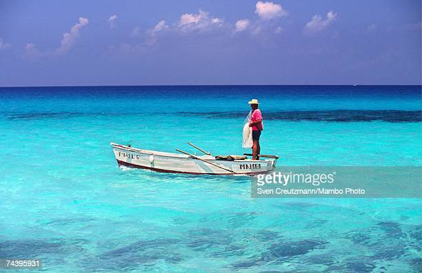 A fisherman prepares to cast his fishing net on June 23 1998 in the town of Cayo Coco in the province of Ciego De Avila Cuba