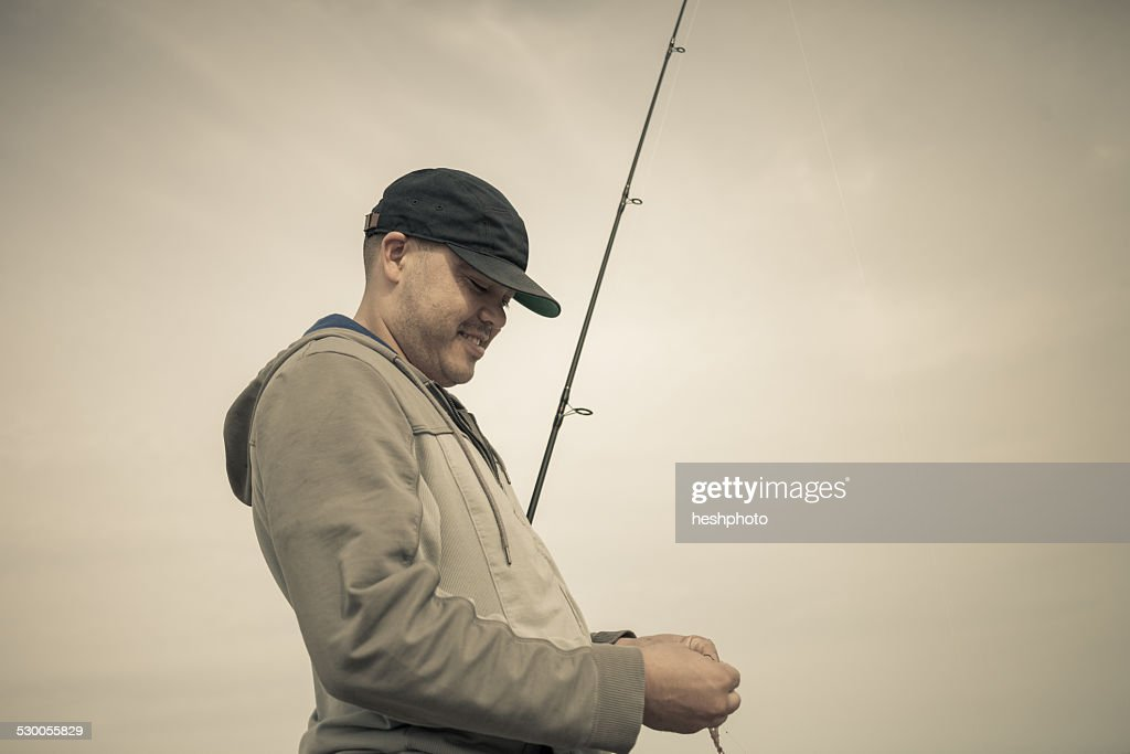 Fisherman preparing fishing rod, Truro, Massachusetts, Cape Cod, USA