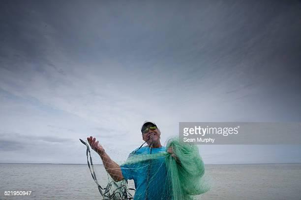 Fisherman Preparing to Cast a Net