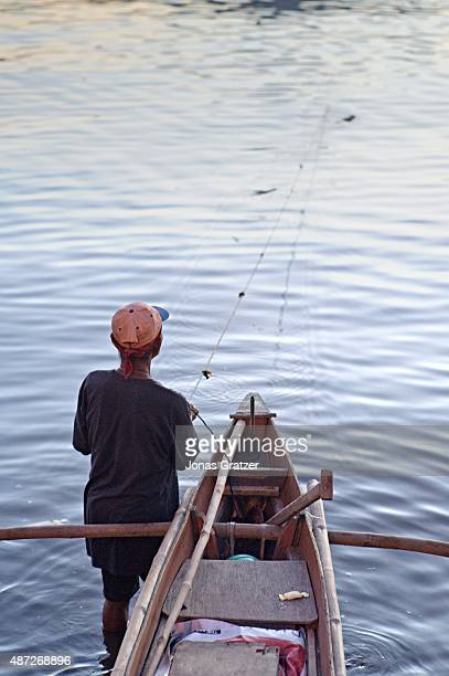 A fisherman pulls in his nets to look at the day's catch