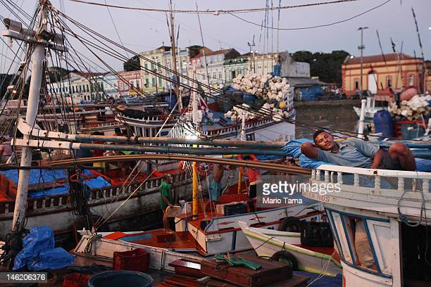 A fisherman rests on his boat docked at the historic VeroPeso market on June 7 2012 in Belem Brazil Belem is considered the entrance gate to the...
