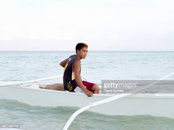 Fisherman Robert Illut going fishing in his pump boat Talisay Santa Fe Bantayan Island The Philippines On November 6 2013 Typhoon Haiyan hit the...