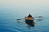 Fisherman rowing a skiff in Buck's Harbor, Maine