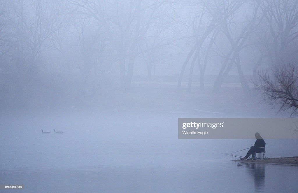 A fisherman sits in a dense fog at Sedgwick County Park in Wichita, Kansas on Friday morning, February 8, 2013. The fog was on the leading edge of clouds moving west through the area, according to National Weather Service meteorologist Jerilyn Billings.