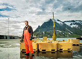 Fisherman standing at fishing industry