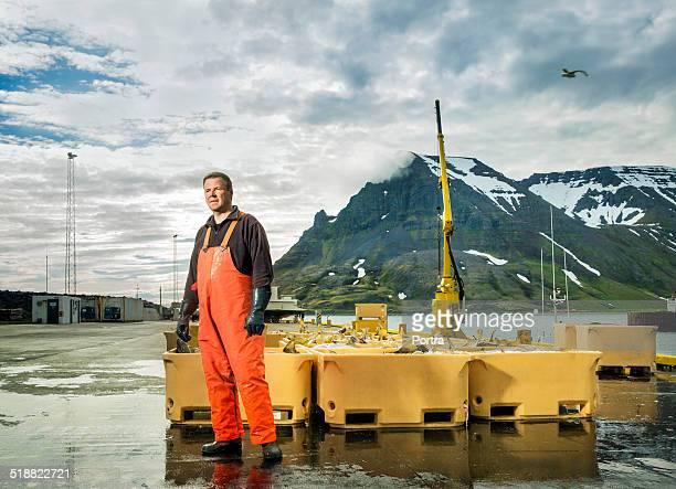 Fisherman standing at fishing industry