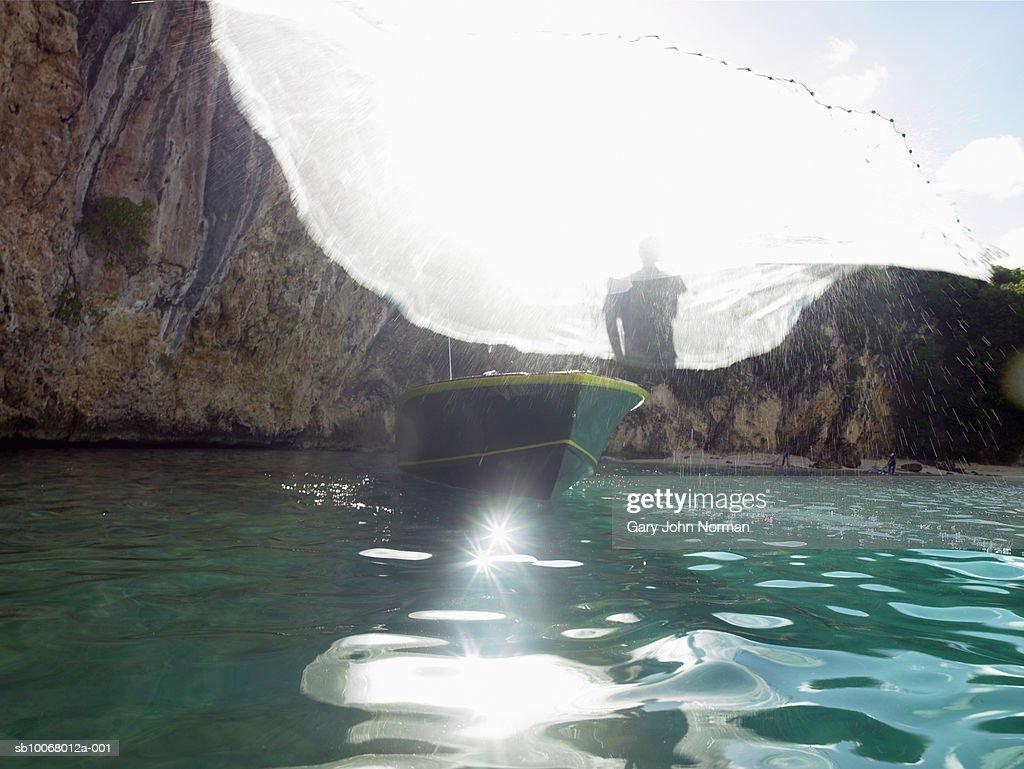 Fisherman throwing net : Stock Photo