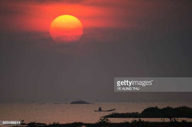 A fisherman travels in a boat in the Moe Yun Gyi wetlands in Bago Division around 70 miles north of Yangon on February 2 2017 Myanmar marked...