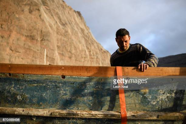 Fisherman Wayne Yon continues renovation work on his boat 'Tina' on October 23 2017 in Jamestown Saint Helena The waters around the island contain...