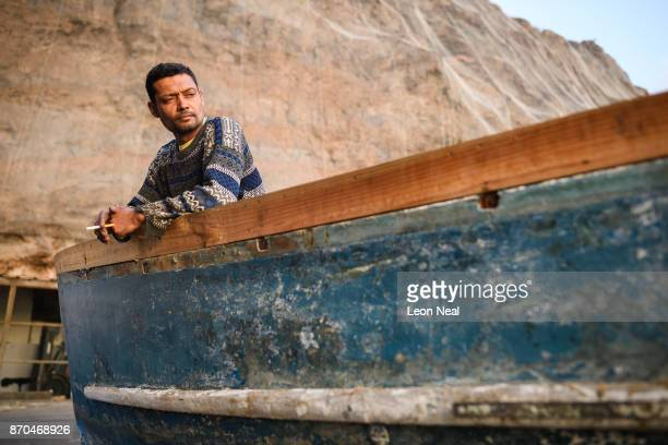 Fisherman Wayne Yon takes a break from renovation work on his boat 'Tina' on October 23 2017 in Jamestown Saint Helena The waters around the island...