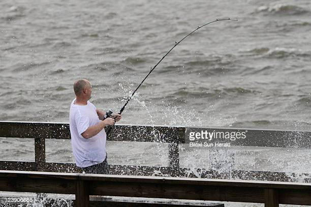 Fisherman William Bailesis gets sprayed with rough waters from Tropical Depression Lee that hit the Lighthouse Pier in Biloxi Mississippi Monday...