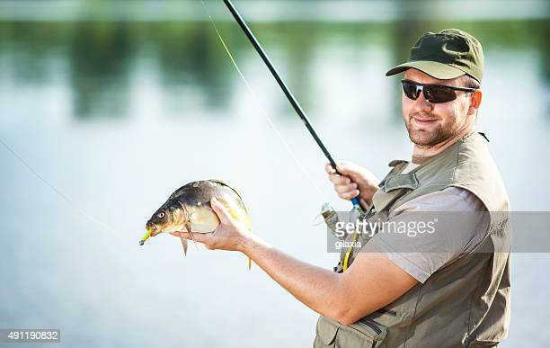 Fisherman with a catch.