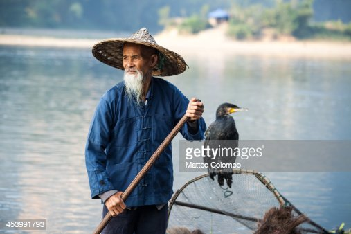 Fisherman with cormorant on Li river China