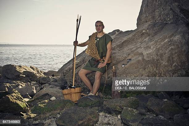 Fisherman with fish trap and harpoons Illyrian civilisation mid3rd century BC Historical reenactment