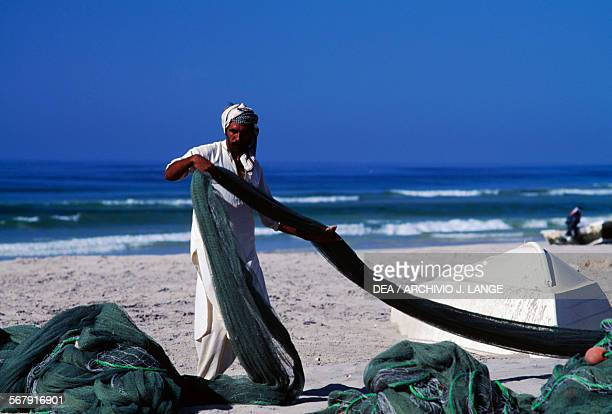 Fisherman with fishing nets Taqah Oman