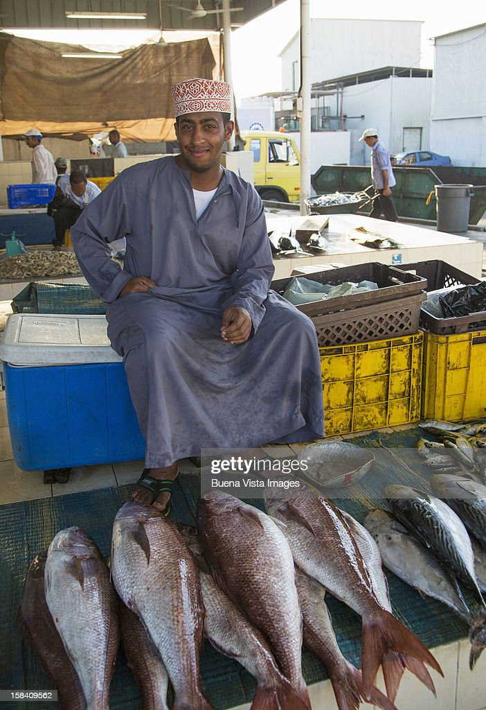 Fisherman with his catch in fish market : Stock Photo