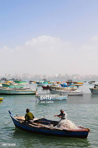 Fisherman with nets in Alexandria Harbor in Egypt