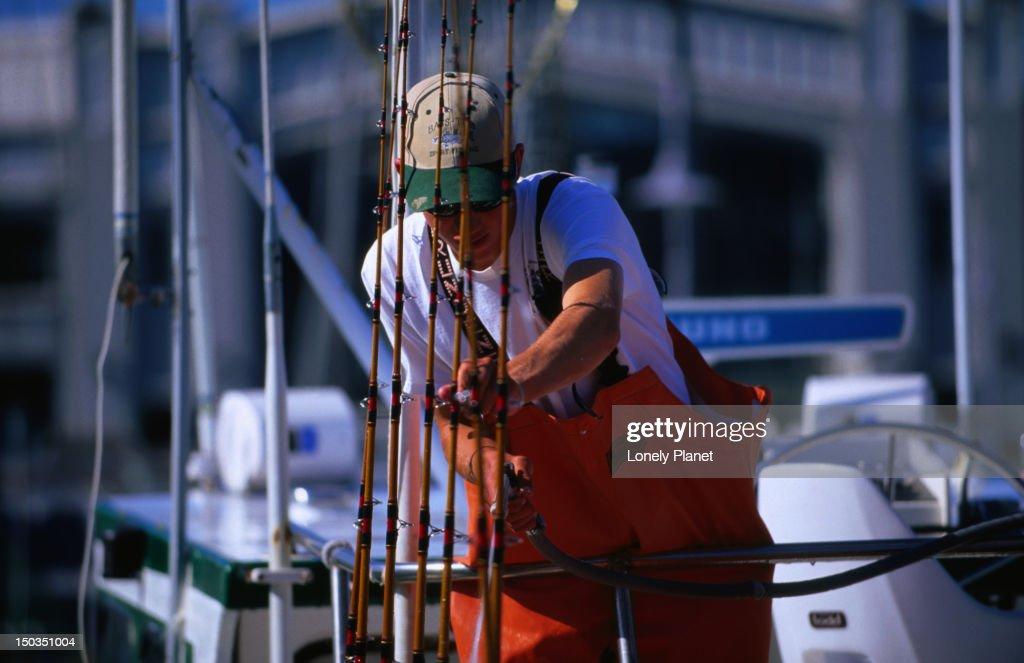 Fisherman with rods at Fisherman's Wharf. : Stock Photo