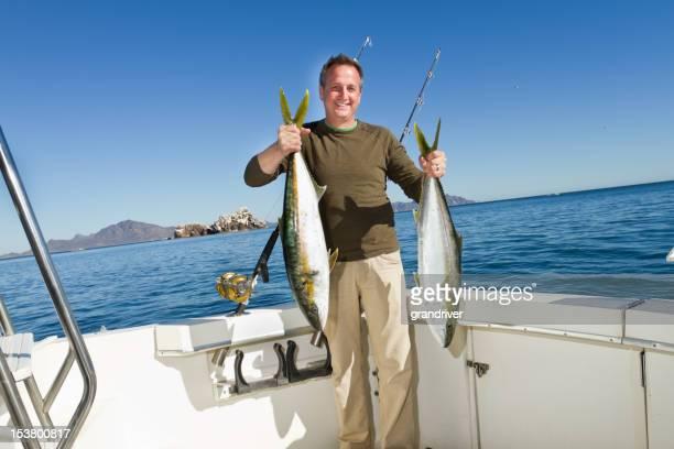 Fisherman with Tuna or Yellow Tail Mackeral Fish