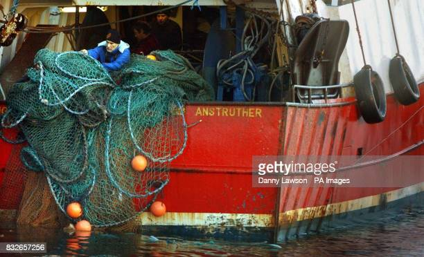 A fisherman works in Pittenweem on the East Coast of Scotland