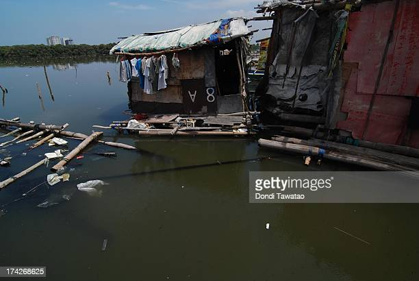 A fisherman's shanty lie in the polluted and garbage filled waters in Manila Bay on July 23 2013 in Manila Philippines Water sampling conducted by...