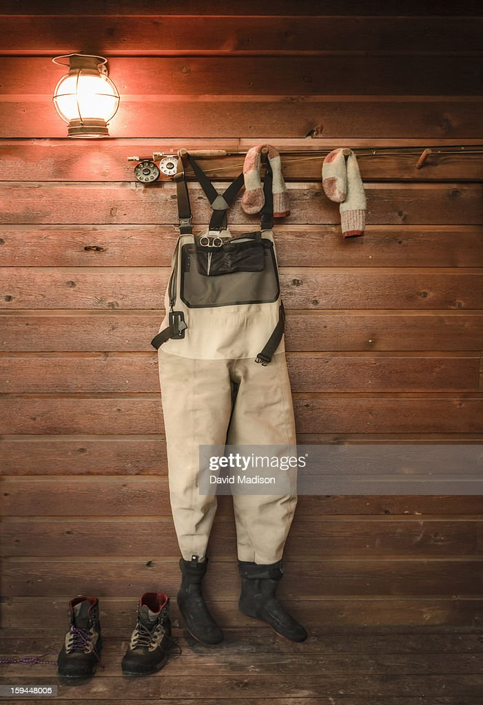 Fisherman's waders, rod and boots.