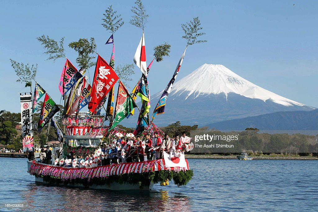 Fishermen and boys dressed and make-up as women dance on a decorated boat during annual Ose Festival at Suruga Bay on April 4, 2013 in Numazu, Shizuoka, Japan. The festival, to pray for the safety at sea and good harvest, is held April 4 every year.