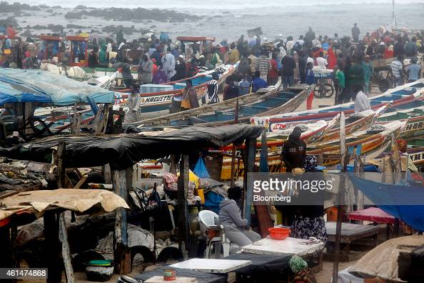 Fishermen and fish traders operate at the Yoff beach fish market in Dakar Senegal on Monday Jan 12 2015 Dakar with 3 million residents according to...