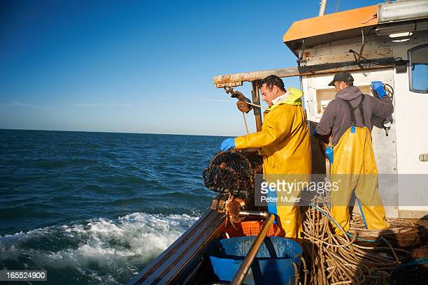 Fishermen at work on boat