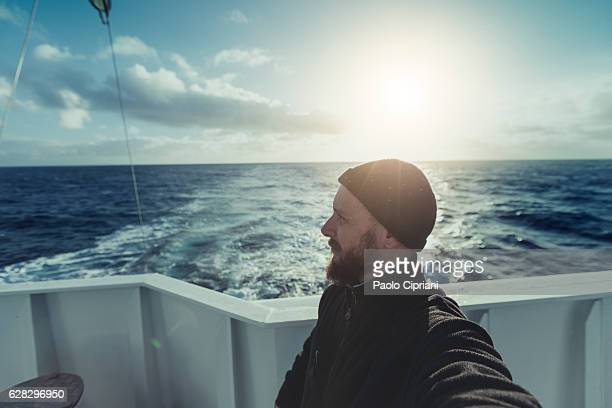 Fishermen at work: selfie from the trawler with sailing